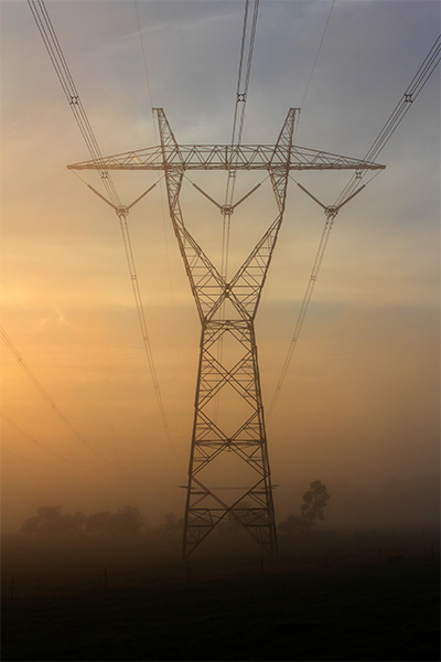 Giant in the Mist - power transmission - power - electricity - Jim Worrall - fog - mist - dawn